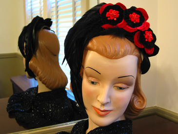 feathered headpiece with red and black flowers